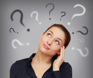 Image of lady with question marks above her head